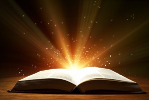 bigstock-Old-open-book-with-magic-light-59870006-1030x691